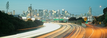 Highway to San Francisco city. San Francisco skyline. Topic: Mobility.